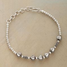 QUEEN OF HEARTS BRACELETS -- A half dozen sculpted hearts join sterling beads on our sweetly sentimental bracelet. Sterling silver S-clasp. 7L, plus extender chain.