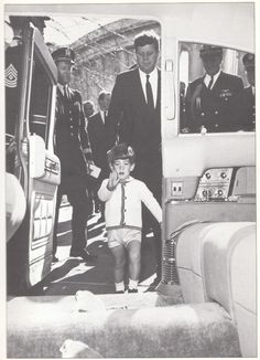 A week before his father's assassination JFK, Jr. marches into the presidential limousine. The President had just placed a wreath on the graves of the Unknown Soldiers in a Veterans Day ceremony, November 11, 1963.