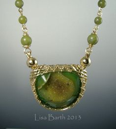 This piece has a double bail on a woven bezel pendant.  The back side if beaded in so it is reversible.