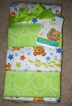 New Disney Baby Finding Nemo 4 Flannel Blankets Lot Receiving Boys Girls Nuetral Ordered these on Ebay, they cost $40, a lil much, but they're cute, and I'm excited to get them in the mail!