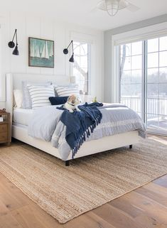 white upholstered bed lake house master bedroom blue and white lakehouse master bedroom 115193702956084309 Farmhouse Master Bedroom, Home Bedroom, Beach House Interior, Bedroom Interior, Coastal Bedroom Decorating, White Upholstered Bed, Home Decor, House Interior, Blue Bedroom