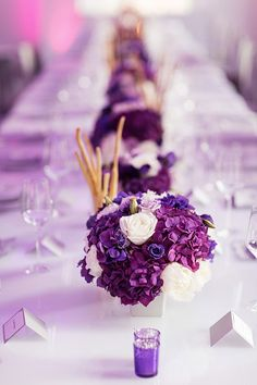 Purple tablescape...to make especialy vibrant purple hues that really stand-out, use Just for Flowers translucent sprayable dye. (Mixing a few colors for a more natural and varigated look is our favorite!)