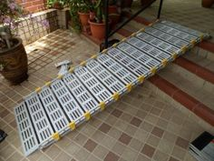 Portable aluminum ramp for easy wheelchair access up some stairs. Take it with you on the go!   www.rollaramp.com
