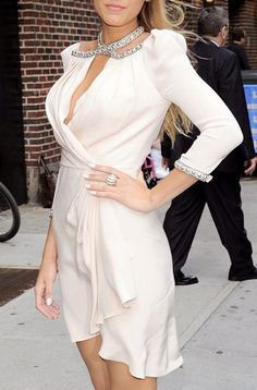 I like the sheer wavy light dress which is short and flows with the wind. Wrap around style is in.