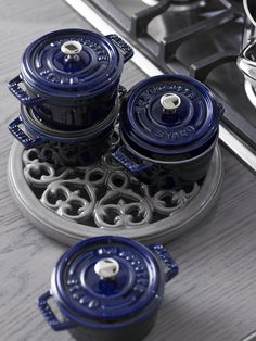 These diminutive round cast iron cocottes from Staub have been created and perfected in the style of the French oven and are perfect for seamless stovetop or oven cooking to table presentation.