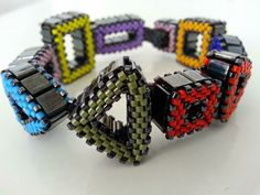 Shape Up Bracelet   Gunmetal & Rainbow by Damnedhalo on Etsy, £65.00