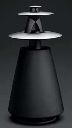 Beolab 5. Omnidirectional speaker. Acoustic lenses on top for omnidirectional treble also. Active speaker with built-in amplifiers and room-correction DSP.