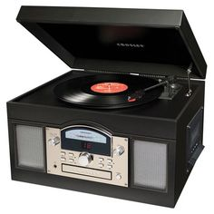Remote-controlled turntable with a USB port and built-in AM/FM radio, CD, and cassette player.  Product: TurntableCo...