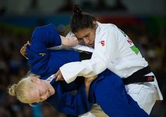 Handout image supplied by OIS/IOC showing Cherine Abdellaoui ALG (blue) battles with Michele Aparecida Ferreira BRA during the Women -52 kg Judo Bronze Medal bout at the Carioca Arena 3 during the Paralympic Games, Rio de Janeiro, Brazil, on September 8, 2016.  Photo by Thomas Lovelock for OIS/IOC via AFP.  RESTRICTED TO EDITORIAL USE..Abdellaoui won the Bronze. / AFP / Thomas Lovelock for OIS/IOC