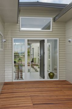 Scyon Linea Weatherboard, merbau decking, white windows, White Duck Dulux exterior paint.