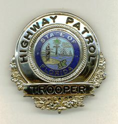 Florida Highway Patrol Trooper badge- I can't wait to get a tattoo in honor of my grandfather who is soon retiring from the Florida Highway Patrol. Very glad he is pursuing his much loved hobbies now, we always continue to worry about him when he is out on the roads.