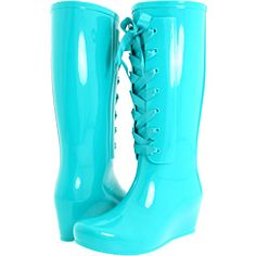 Turquoise rain boots. Making rainy days better one step at a time.