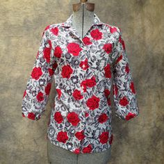"""Vintage 1980s Black Rose Blouse Puff Sleeve. Women's Medium. This blouse has a 3/4 sleeve with extra gathering like a bishop sleeve. It's a fun top for work or play.  Size: fits like a modern Medium Chest: 40"""" Shoulders: 16"""" Sleeve: 16"""" Length: 26""""  Brand: Booth Bay, Nylon Colors: White, red, black"""