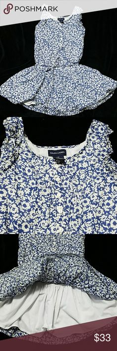 Ralph Lauren blue and white flowered dress 100% cotton outer fabric, 65 35 cotton poly inside fully lined layer, slouched waste with fabric belt, 5 dainty buttons at neckline along with dainty ruffled sleeves. Perfect for that outdoor party this summer!  Excellent condition, no tears, no stains, pet free and smoke-free home Ralph Lauren Blue Label Dresses