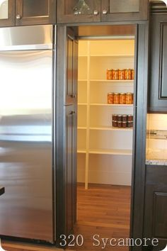 The door past the fridge looked like cabinets, but it opened up into a pantry behind, allowing the fridge to be flush with everything else -. - Home Decorating Magazines Küchen Design, Home Design, Layout Design, Secret Rooms, Parade Of Homes, New Kitchen, Kitchen Pantry, Kitchen Ideas, Kitchen Cabinets