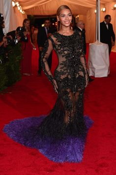 Beyonce stuns in black lace on the red carpet of the MET Gala in NYC. See full gallery here: http://bit.ly/ISkhB2