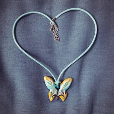 "Let this lovely butterfly land on your neck.  The ""Papillon Collection"" is Hyccara's most youthful collection, inspired by the beauty of spring and nature. Choose one in your favorite color and wear this sweet butterfly necklace as a celebration of femininity.     MADE IN FRANCE  Brand : Hyccara Color : blue, yellow, white, black  Pendant size : 4cm x 3.8cm Materials : Enamel (crystal powder), copper, metal clasp, cotton Certificate of Authenticity included  Artisan made Blue Yellow, Color Blue, Copper Metal, Butterfly Necklace, Femininity, Authenticity, Certificate, Favorite Color, Celebration"