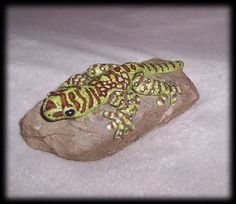 hand sculpted gecko on a rock painted by MoondropsArt on Etsy, $32.00