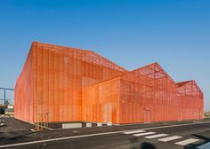 Manuelle Gautrand splits exhibition centre into 13 orange blocks