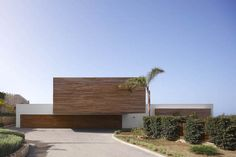 Wood-Cladded Dream Home in Almunecar: Pure White