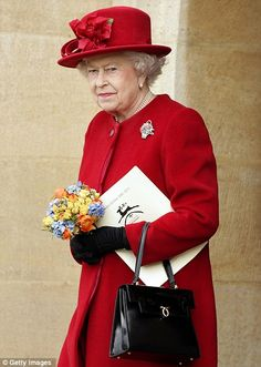 Queen Elizabeth II wears red during a visit to Guildford Cathedral.