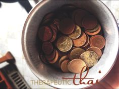 www.therapeuticthai.com 108 coins for the 108 bronze bowls, representing the 108 auspicious characters of Buddha. In Temple of Reclining Buddha, Wat Pho, Bangkok, Thailand