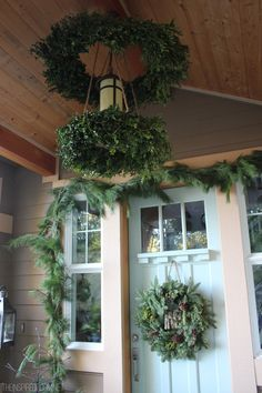 How to make a boxwood wreath chandelier! It's gorgeous all day long and SO magical at night with the lights on! Come see the easy step by step tutorial.