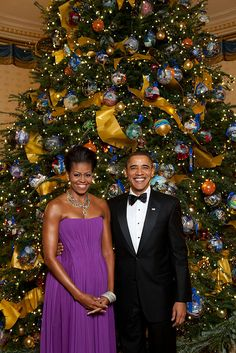 President Barack Obama and First Lady Michelle Obama pose for a formal portrait in front of the official White House Christmas Tree in the Blue Room of the White House, Dec. 6, 2009.