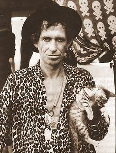 Keith Richards. I wonder if he even knows he's holding a kitty.