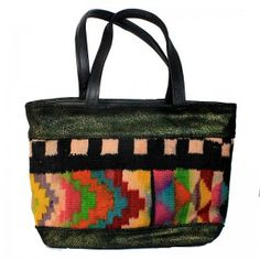 """Black and green sparkly leather and vintage Navajo rug tote.  Black leather handles. Interior with 3"""" leather top and beautiful lime green lining. One leather zippered interior pocket and 2 open hand beaded, fabric pockets. Leather strap with brass toggle for easy to find keys. Magnetic closure. 18""""wide x 12"""" high with 5"""" soft bottom."""