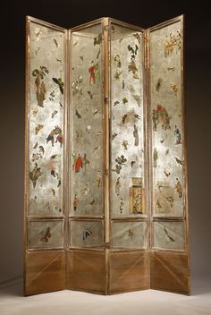 An Art Deco 'Japanese' style decalcomania, silver paper and mirror four-panel floor screen, Circa 1930, each panel decorated overall with figures, flowers, birds and butterflies.
