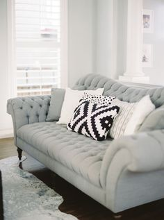 Traditional gray sofa: http://www.stylemepretty.com/living/2015/07/08/the-prettiest-sofas-ever/