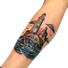 Old-school lighthouse scene inked by @pablo_de_tattoolifestyle