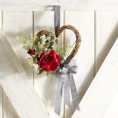 Our mini wreath speaks the language of love, thanks to its faux florals and natural grapevine twined into a heart and finished with a gingham ribbon. Handcrafted exclusively for Pier 1, it's ready to add a romantic touch to your mantel, soffit, door or tabletop.