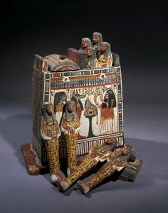 Painted wooden shabti-box containing eight painted shabtis (four in each compartment). 19th dynasty. | The British Museum