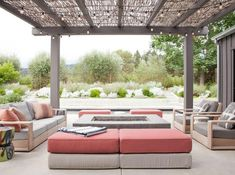 HGTV features a contemporary fire pit under a gray pergola with a bamboo roof and outdoor string lights, plus rose colored outdoor cushions and modern outdoor furniture. Outdoor Seating Areas, Outdoor Living Areas, Outdoor Spaces, Living Spaces, Pergola Designs, Patio Design, Fire Pit Under Pergola, Home Design, Canopy Outdoor