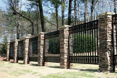 Cozy Cool And Unique Stone Fence Design Ideas With Nice Stone Fence Pillars And Black Iron Fence Design