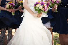 Google Image Result for http://wedding-pictures.onewed.com/match/images/18249/navy-blue-bridesmaid-dresses-wedding-flowers.original.jpg%3F1351022410