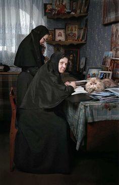 Serafim-Pokrovsky Convent, Leninsk-Kuznetsk, Kemerovo Oblast -- Mother Superior Maria in her office, with feline assistant