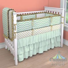 Mint and Gold Crib bedding.  White and Gold Dot, Solid Icey Mint, Mint and Gold Chevron, Solid Gold Satin, Solid White Minky. Created using the Nursery Designer® by Carousel Designs where you mix and match from hundreds of fabrics to create your own unique baby bedding.