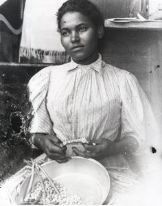 From the Columbus-Lowndes Public Library Marion Stark Gaines Photograph Collection; Photograph of an African American woman shelling peas, circa 1890s.
