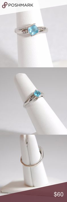 Blue Topaz & Diamond Ring Given to me by an ex - needs to go!  From Helzberg Diamonds in Austin, Texas.  I believe it is white gold, but it could be sterling silver.  4 small diamonds (2 on each side) and 1 blue topaz in the center.  Good condition with some wear and scratches. Pre-loved, but ready to have a new home.  Approximate size = 5.75 ring size Helzberg Diamonds Jewelry Rings