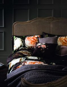 Gorgeous bold floral and black bedding in black panelled bedroom  - one of our picks for the key interior design trends for 2017, combining romantic pinks with dark and moody black for a soft feminine take on the trend for black interiors.