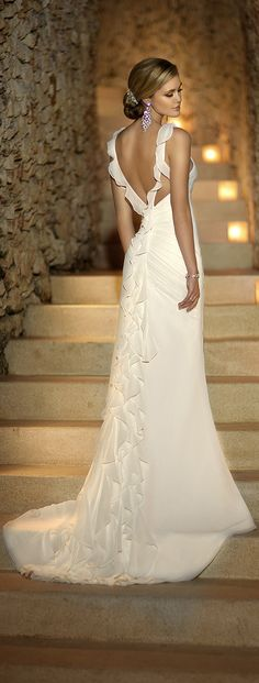 beautiful wedding dress with ruffles down the train