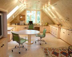 Beautiful attic craft room office - the lighting makes it amazing.