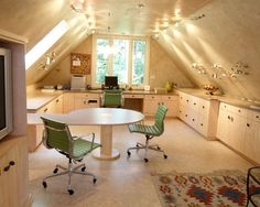 Beautiful attic craft room office - the lighting makes it amazing.