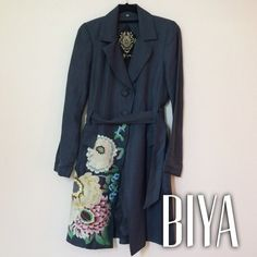 """HP Biya by Johnny Was embroidered duster coat Unique long embroidered coat. From the brand Biya. Three-button closure, collar, long sleeves, two hip pockets, attached belt. Small shoulder pads. Such beautiful embroidery of flowers in pastels along left bottom and wrapping to back of coat.  Size small. Measures 17"""" at bust, 14"""" at waist, and 40.5"""" neck to hem. Dry clean. Like new condition. Had dry cleaned after last use. Perfect coat for a formal event and a way to stand out from the boring…"""