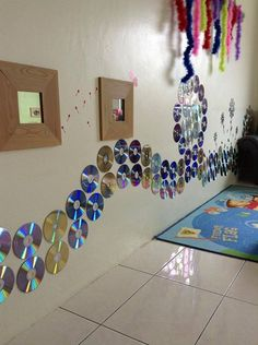 """We already have quite a few CDs on the walls, but I'm liking how these have been made into a patten - from Sin Yee Yap in Malaysia, image shared by let the children play ("""",)"""