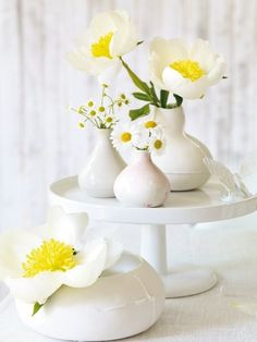 cake plate and little vases of flowers.