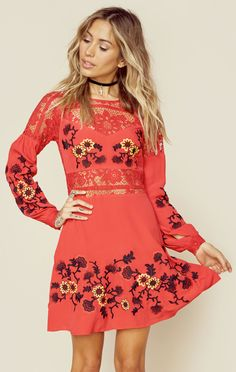 The Isabella Dress by For Love and Lemons embodies a romantic look with its beautifully embroidered floral design, contrasting lace panels, and a loose swingy fit.